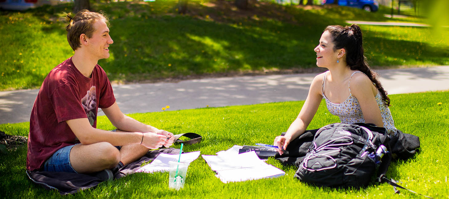 Two students studying outside