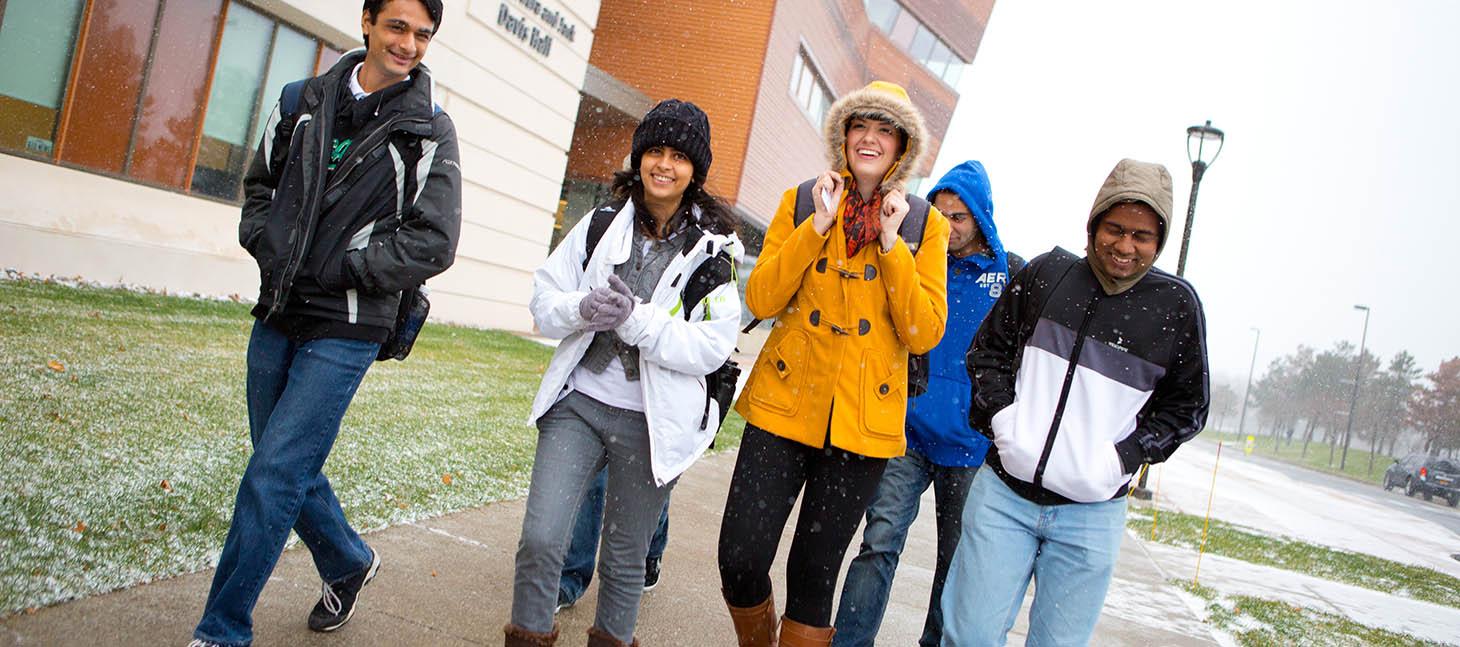 Students walking outside in the winter