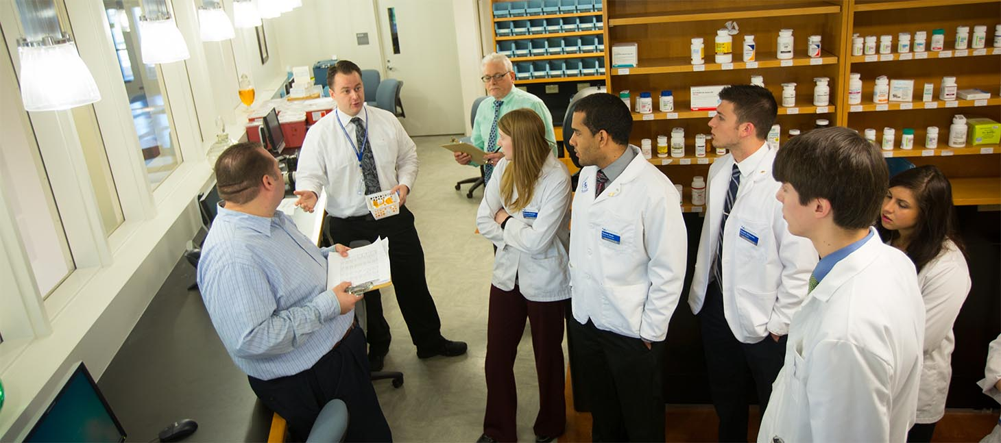 Pharmacy students listenting to faculty.