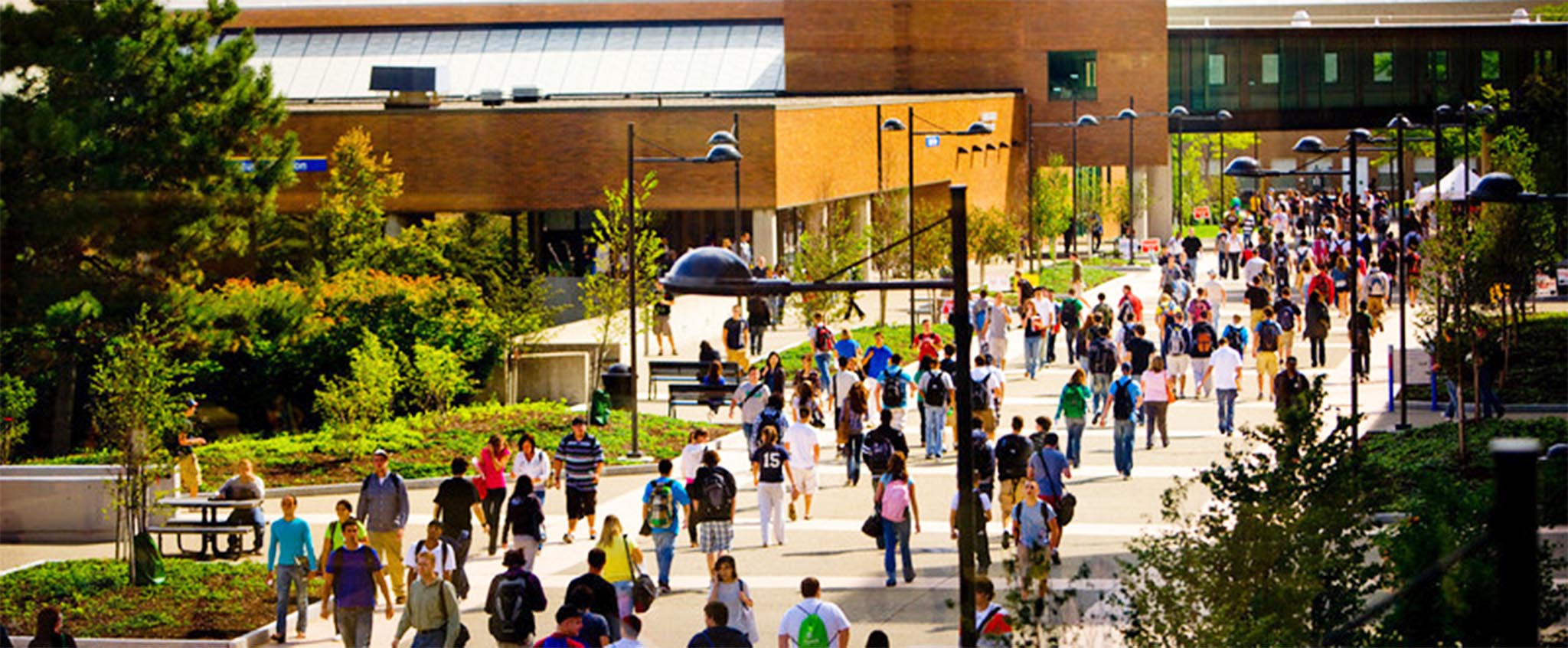 Students walking on Founder's Plaza on a sunny day.