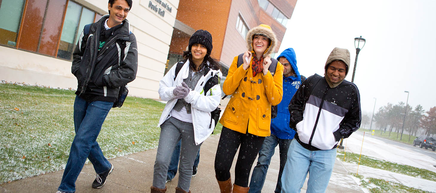 Students walking outside in the winter