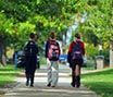 Students with backpacks walking on campus